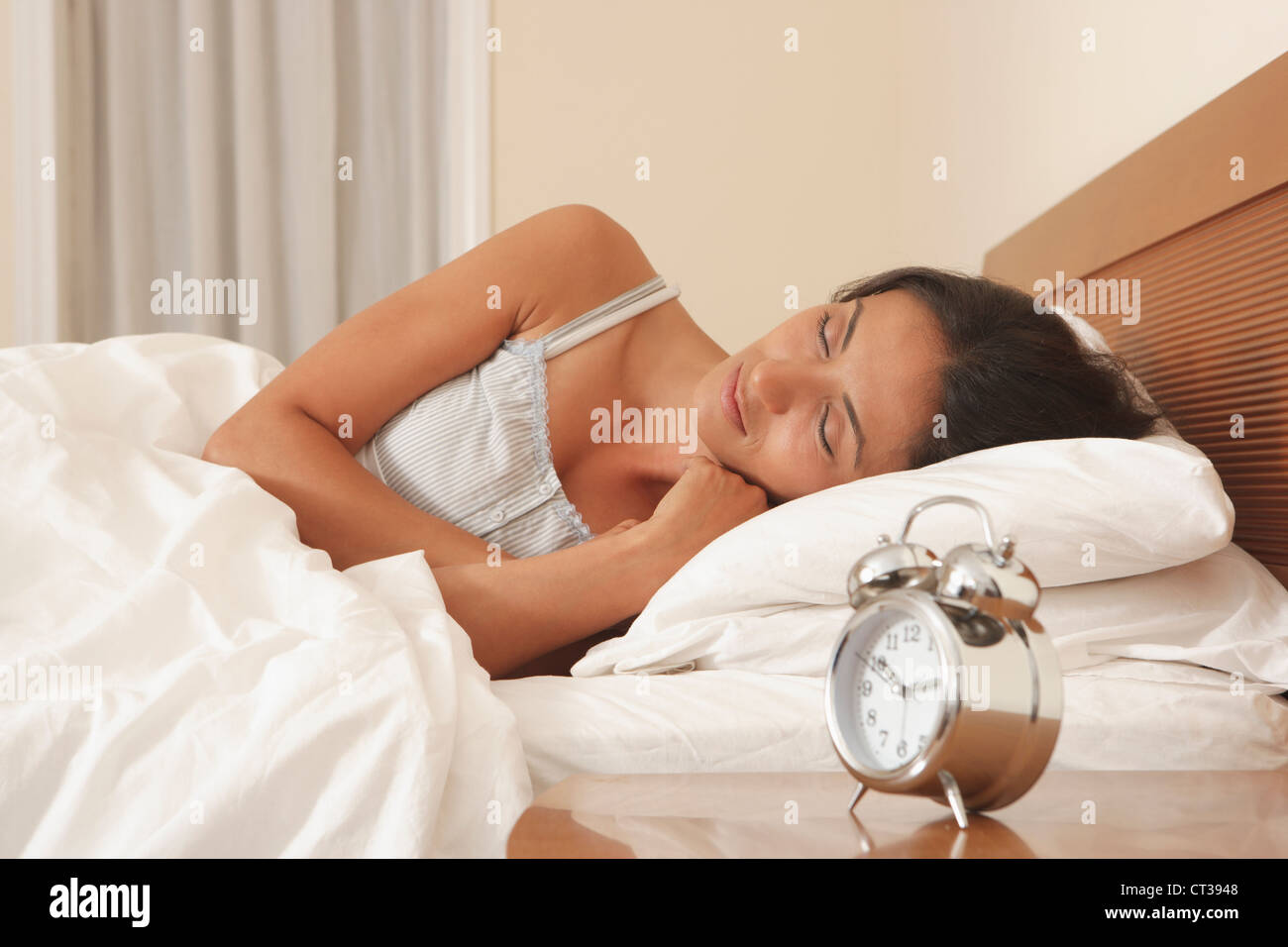 Woman asleep in bed - Stock Image
