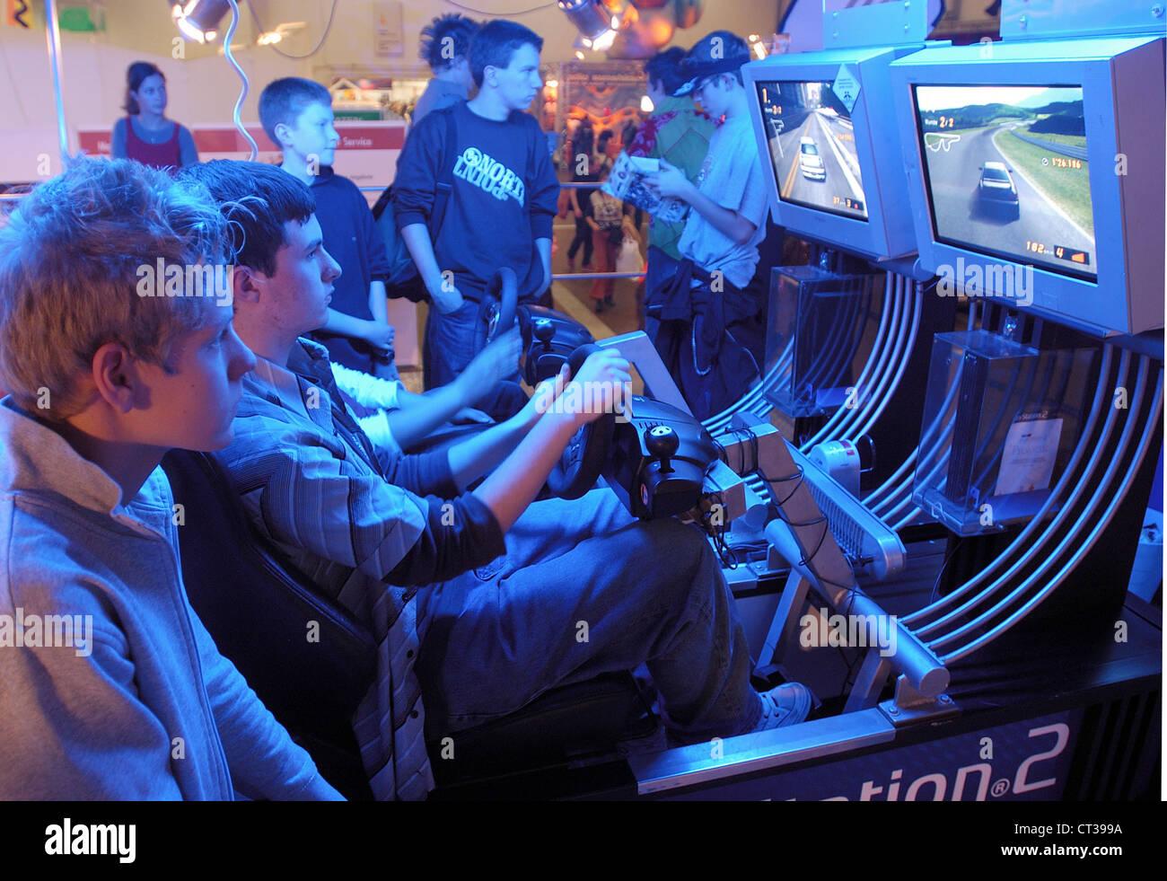 Stuttgart, boys go on a racing simulator - Stock Image