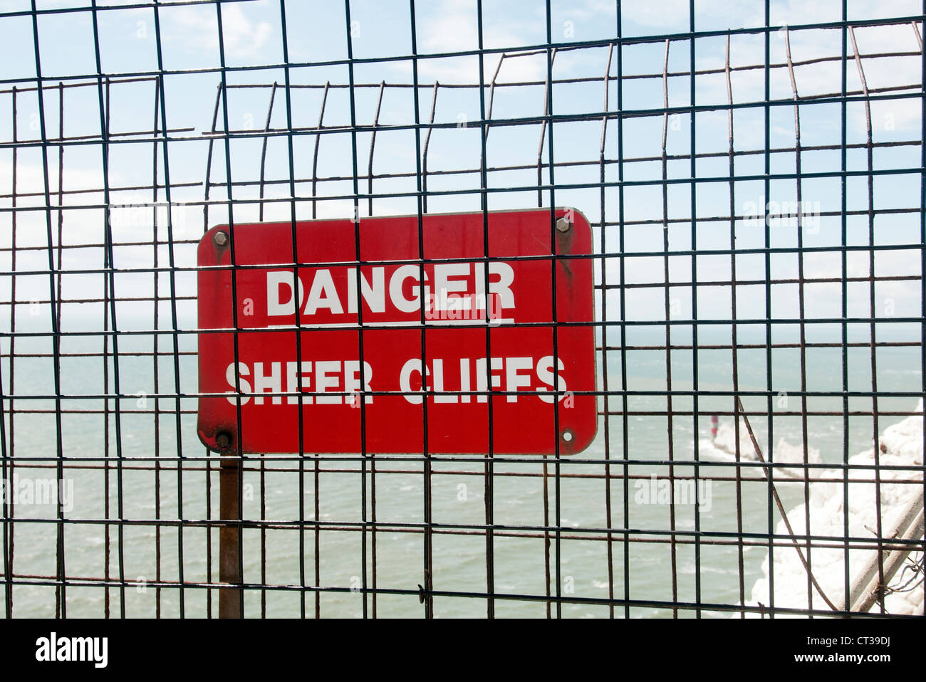 Danger Sheer Cliffs sign at the Needles on the Isle of Wight - Stock Image