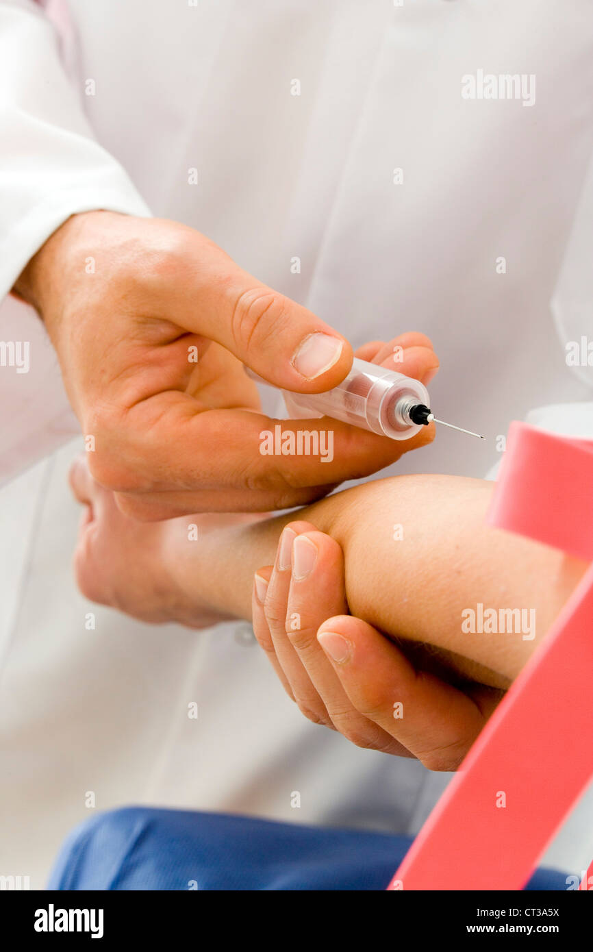 BLOOD SPECIMEN IN A WOMAN - Stock Image