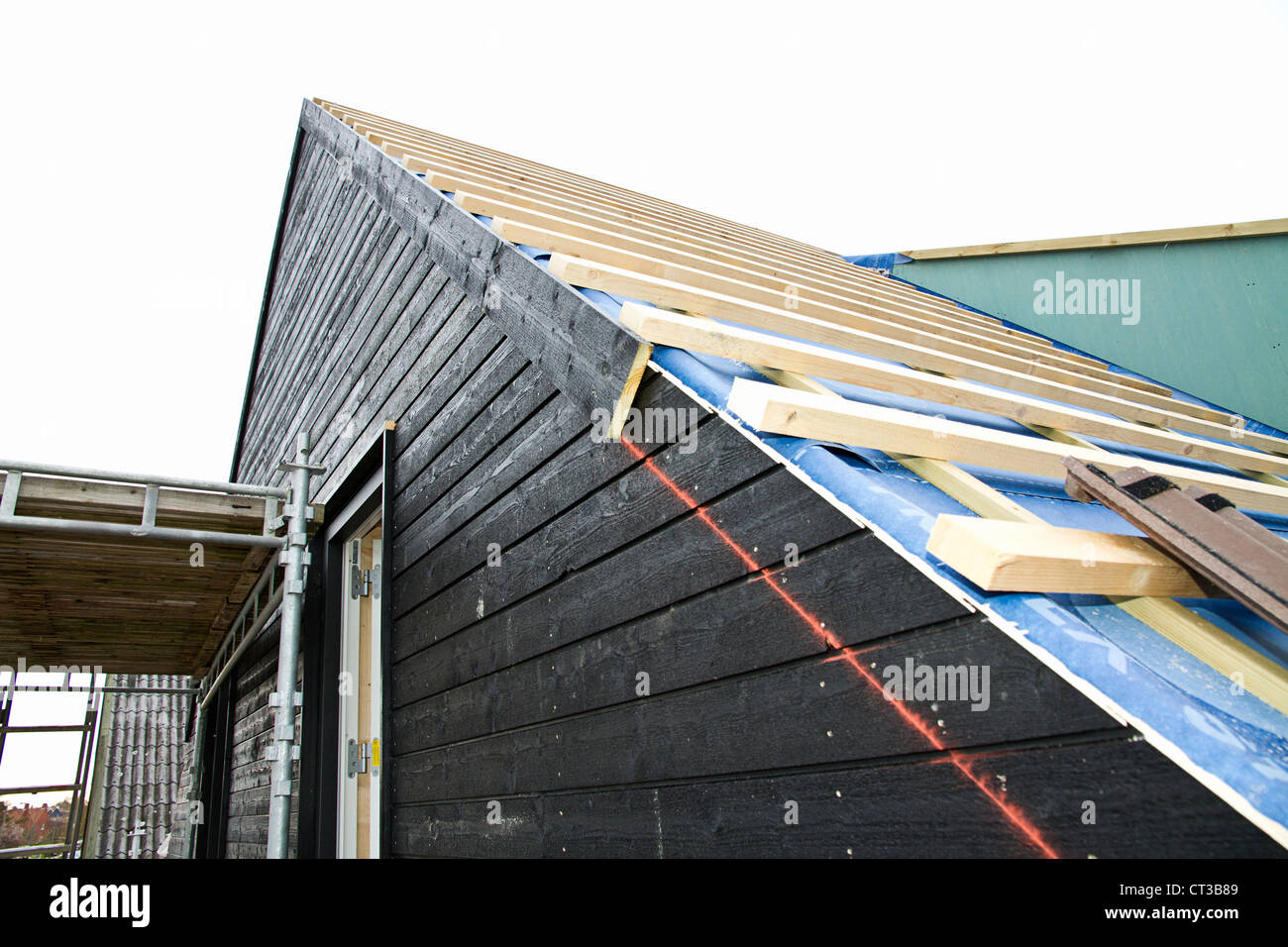 Siding of building under construction - Stock Image