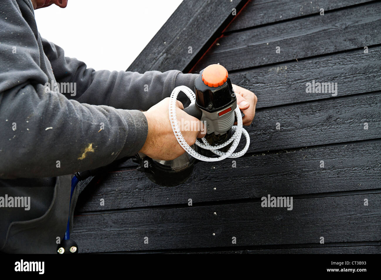 Builder at work on new structure - Stock Image