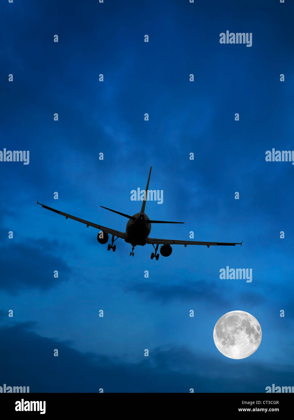 Airplane and Moon in Blue Sky - Stock Image