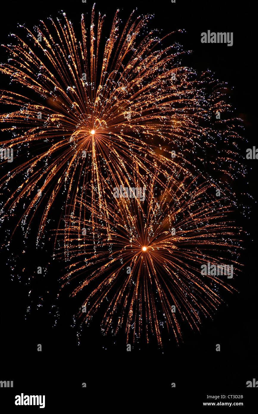 Fireworks against a black sky - Stock Image