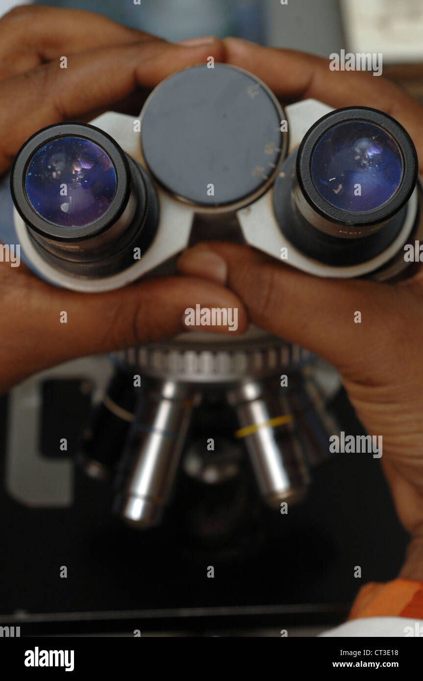Close-up of the eyepiece, which consists of a pair of lenses, on a microscope. - Stock Image