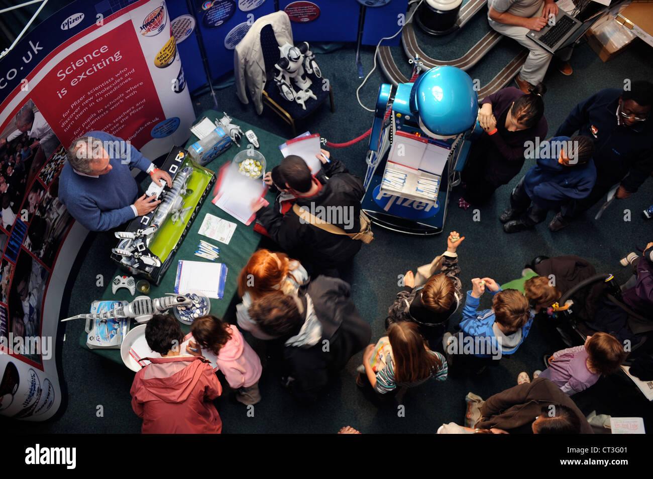 Children meeting a robot at the Cheltenham Science Festival UK - Stock Image