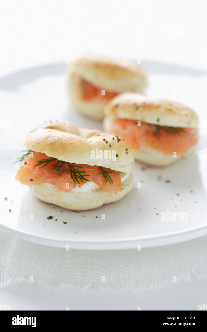 Plate of salmon and cream cheese bagels - Stock Image