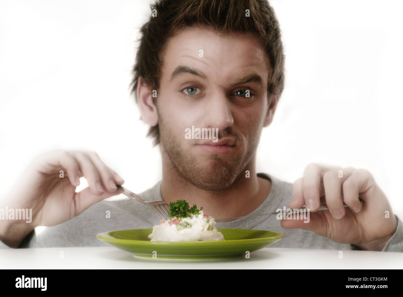 MAN EATING A MEAL - Stock Image