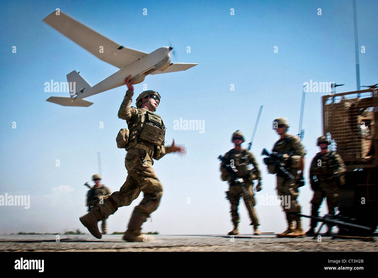 A US Army soldier with the 82nd Airborne Division's 1st Brigade Combat Team, launches a Puma unmanned aerial - Stock Image