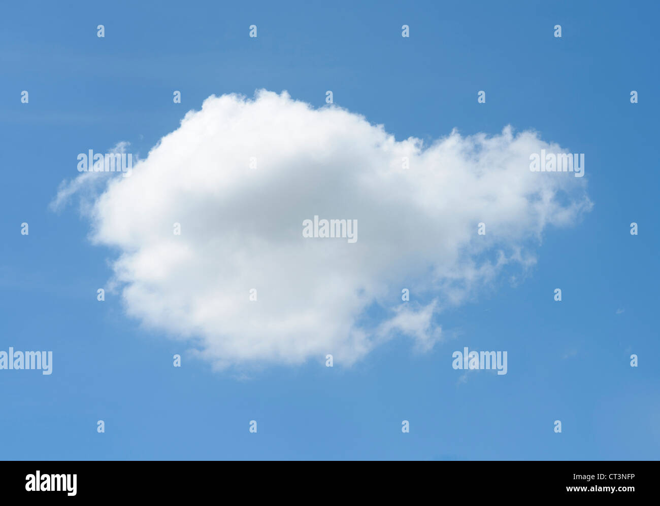 Puffy cloud in blue sky - Stock Image