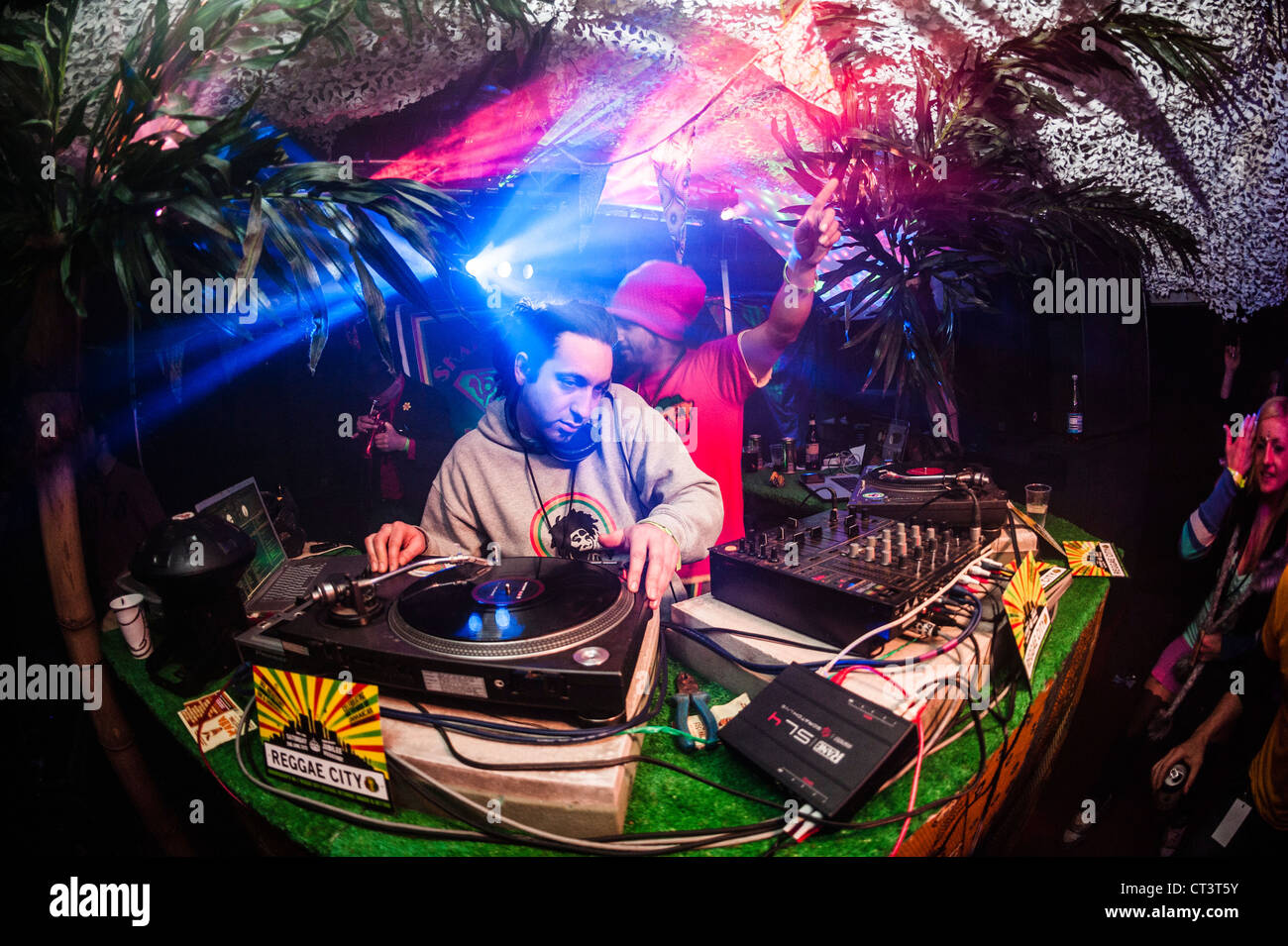 A man DJ'ing at The Rare One music dance party event festival, Wales UK - Stock Image