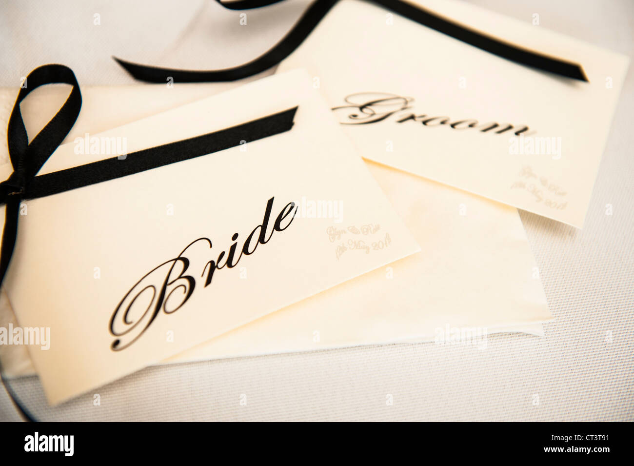 Bride and Groom name tags at a wedding reception - Stock Image