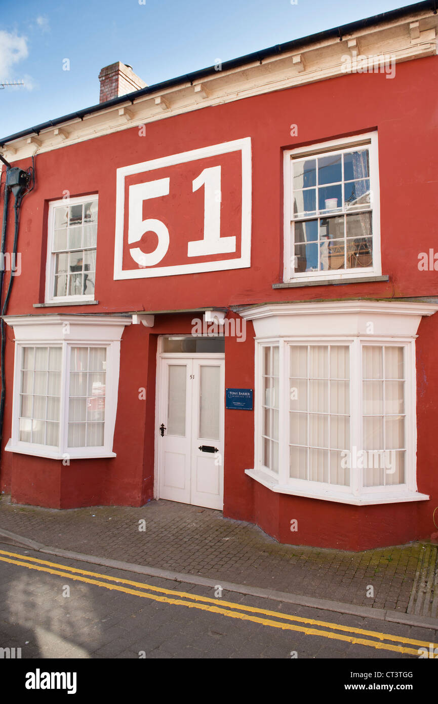 No 51 wrtten large on the outside of a red painted double fronted house Cardigan Wales UK - Stock Image
