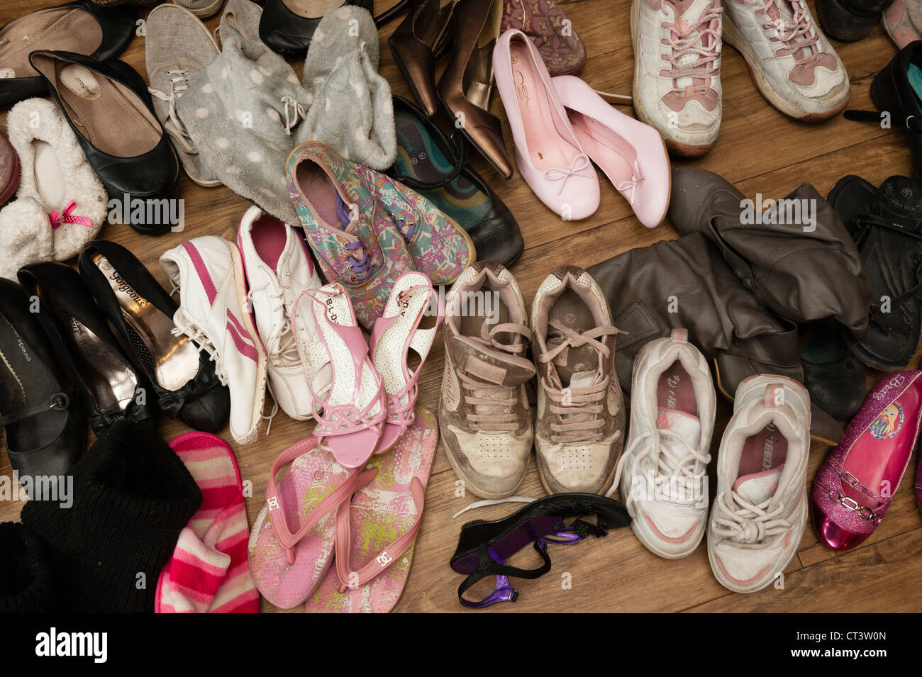 Pairs of old shoes at a jumble sale bring and buy sale UK - Stock Image