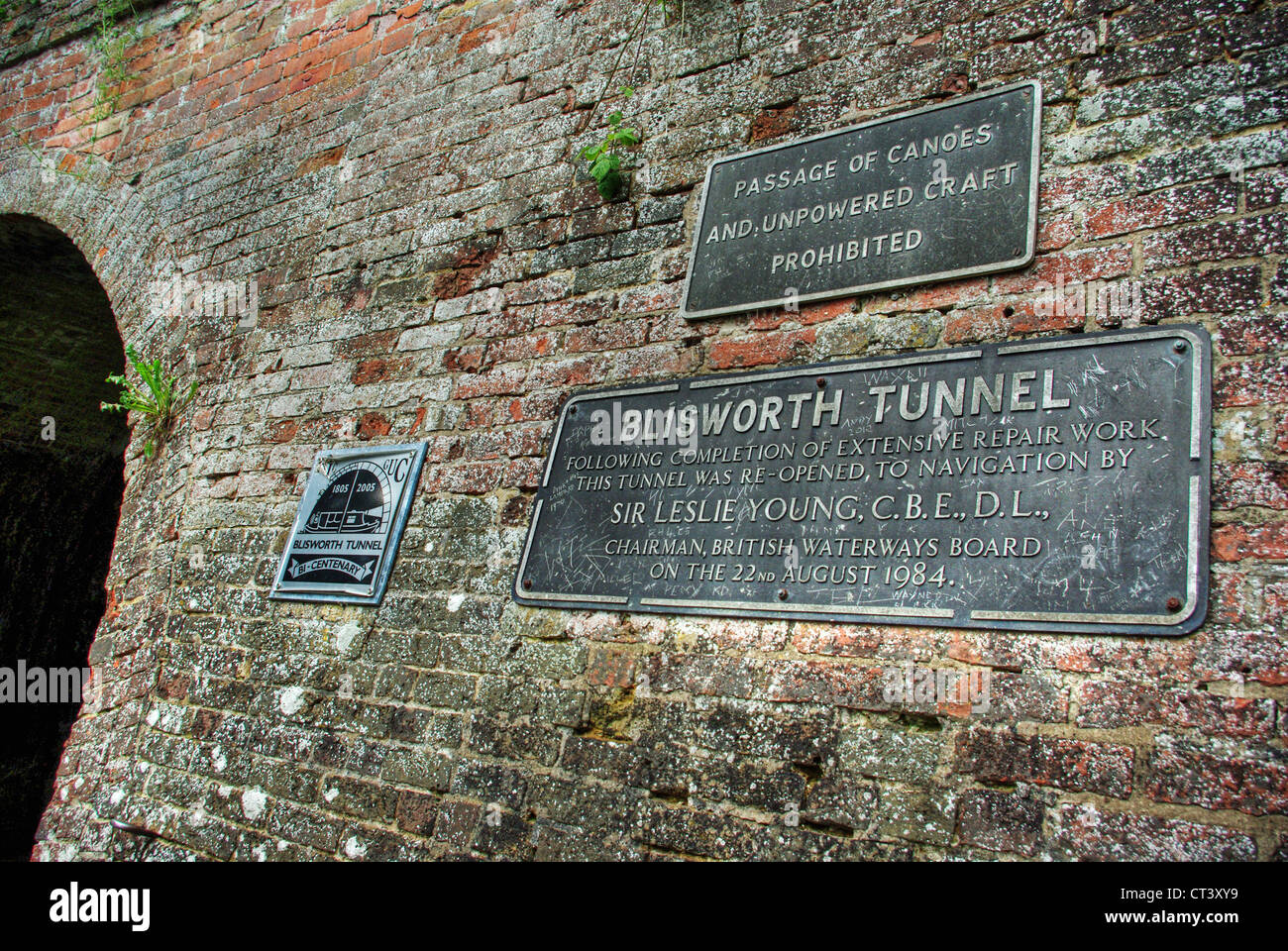 Three metal signs at the entrance to Blisworth tunnel, Stoke Bruerne. - Stock Image