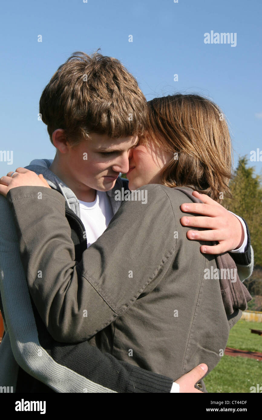 COUPLE OF ADOLESCENTS - Stock Image