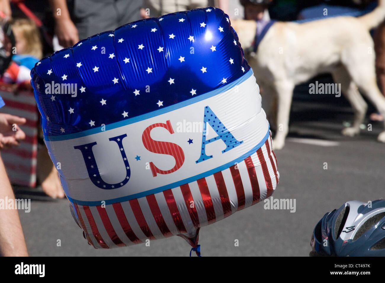 A patriotic USA balloon at a 4th of july parade - Stock Image
