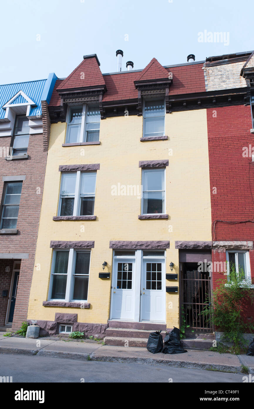 Simple three story row house in Montreal, province of Quebec, Canada. - Stock Image
