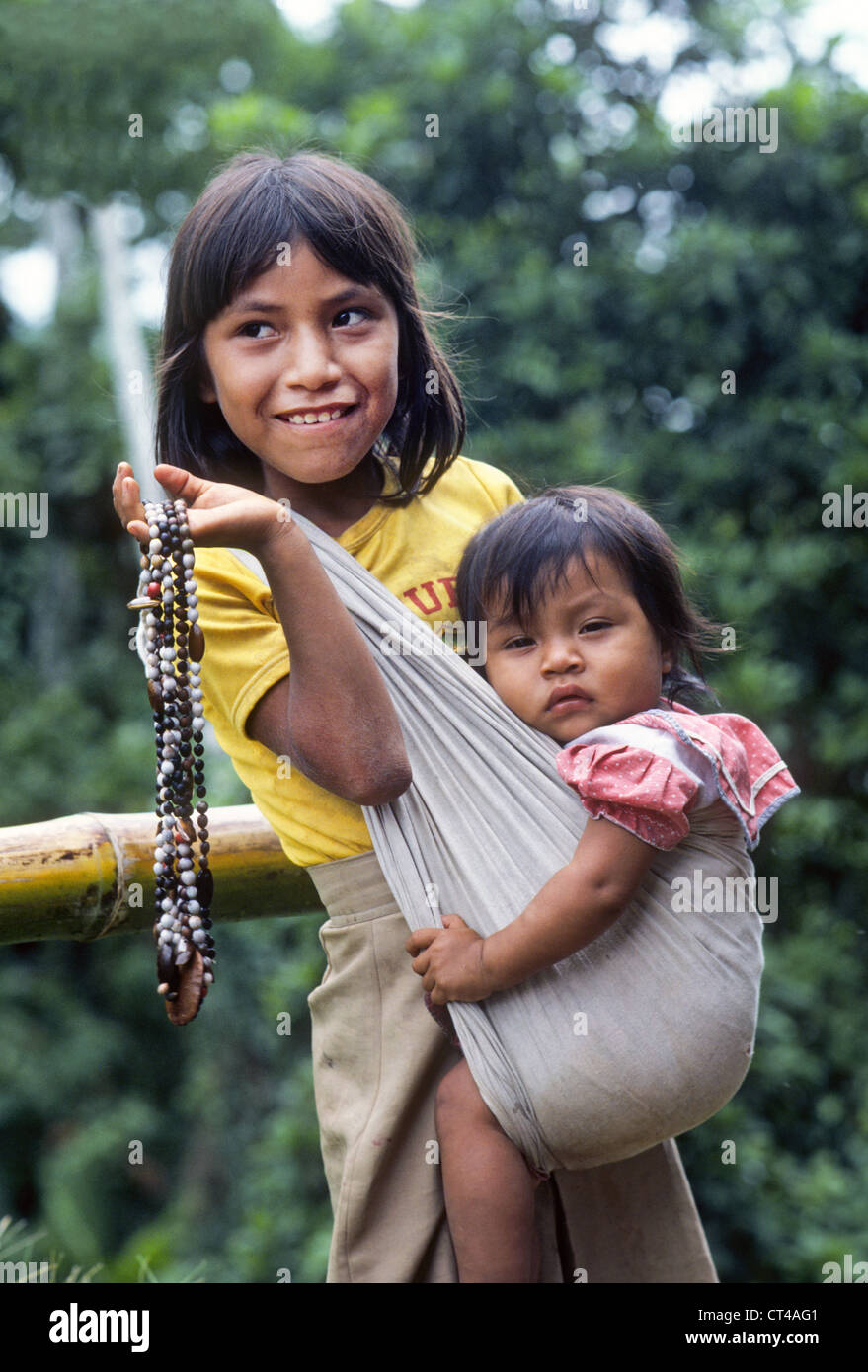 A Young Yagua Indian Girl And Her Little Sister In A Rain -7664