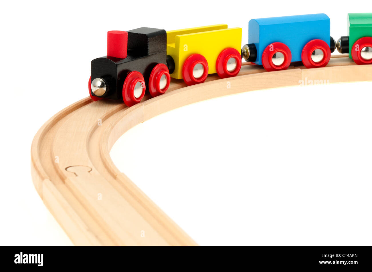 A Child S Wooden Toy Train And Track Studio Shot With A White