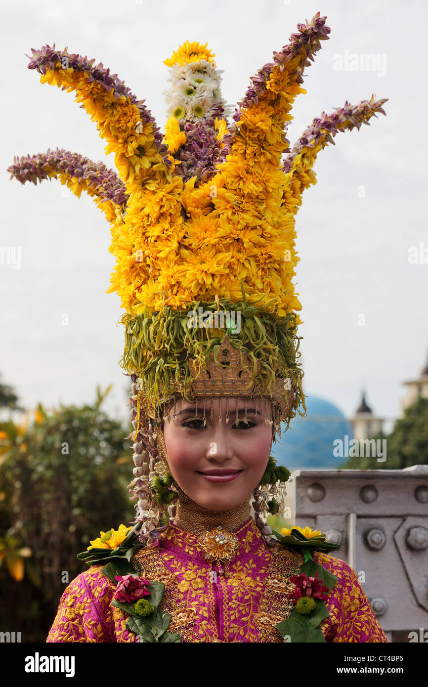 Indonesia, Sumatra, Aceh, Banda Aceh. Woman in traditional dress wearing a floral crown headdress. Stock Photo