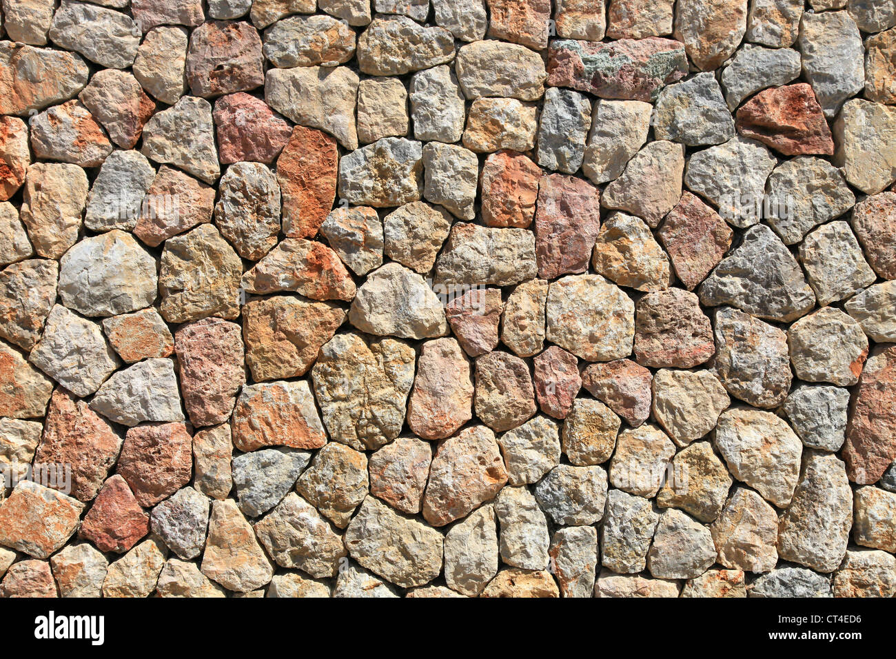 Abstract image of a brightly lit stone wall, these images are perfect for great textures and backgrounds - Stock Image