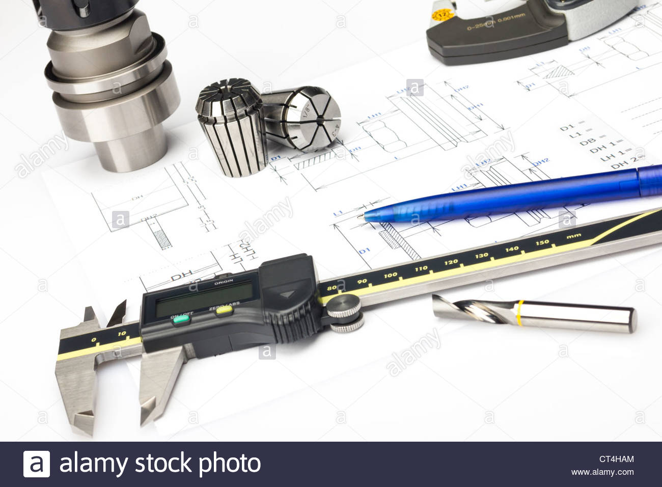 Measuring machining tools - caliper and milling tools on blueprint - Stock Image