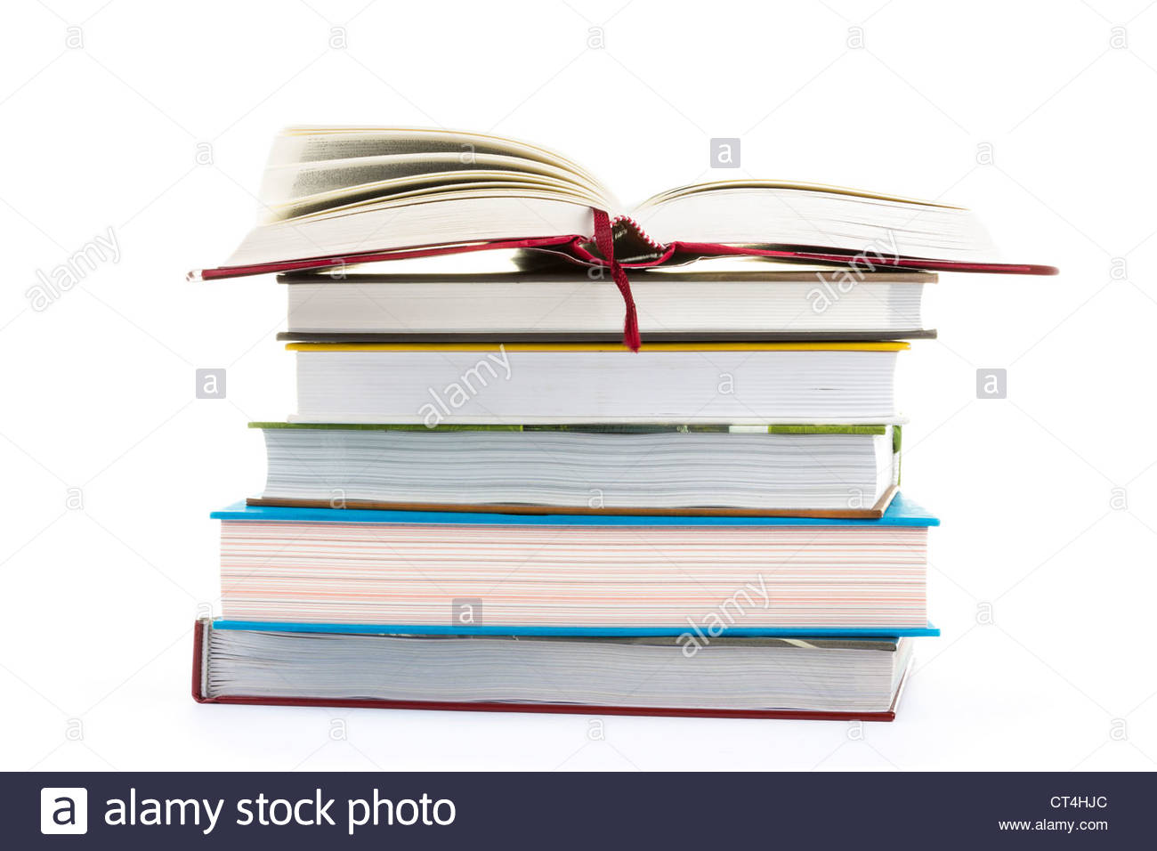Stack of books on white background - Stock Image