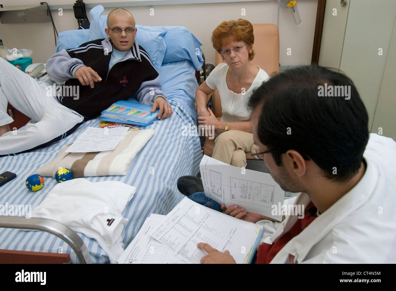 Old Person Hospital Bed Family Stock Photos & Old Person Hospital