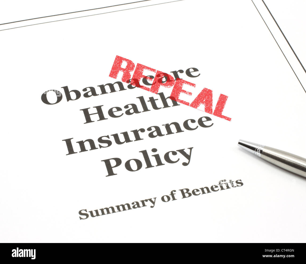 Obamacare government health care insurance program policy with a pen ready to be signed. - Stock Image