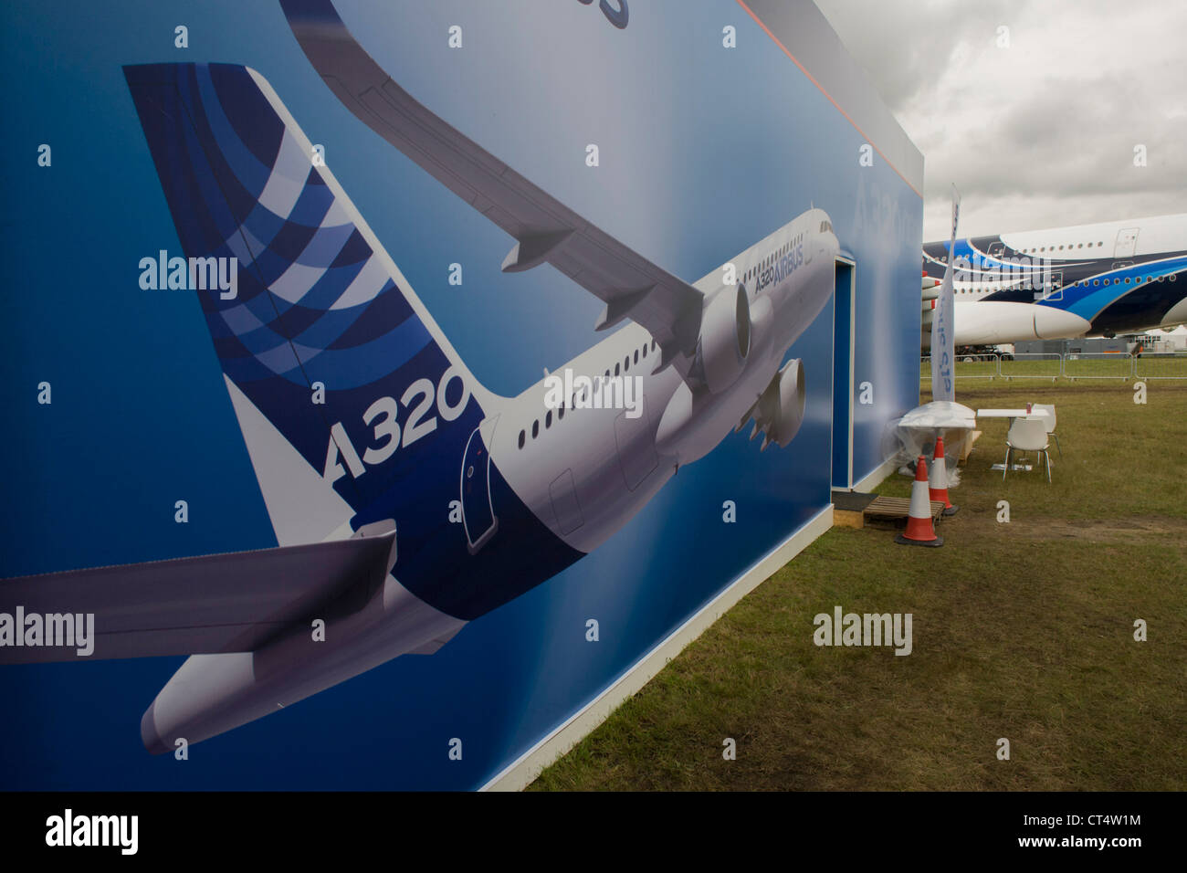 Landscape of a mural artwork of an A320 airliner outside one of the EADS company's chalets at the Farnborough - Stock Image