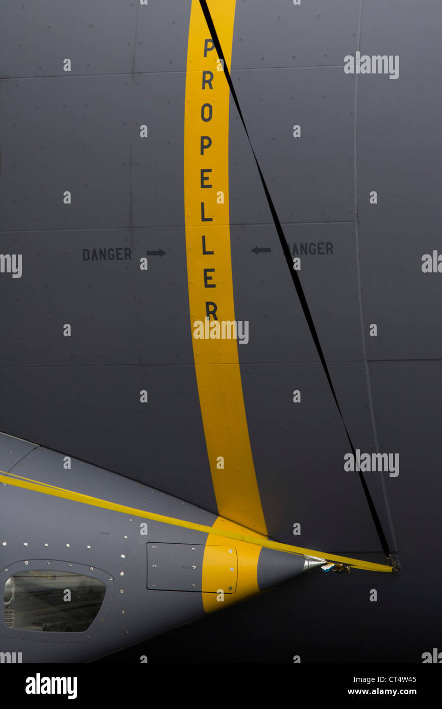 Detail of danger warning signs on the fuselage of an Airbus A400M military transporter at the Farnborough Air Show, - Stock Image