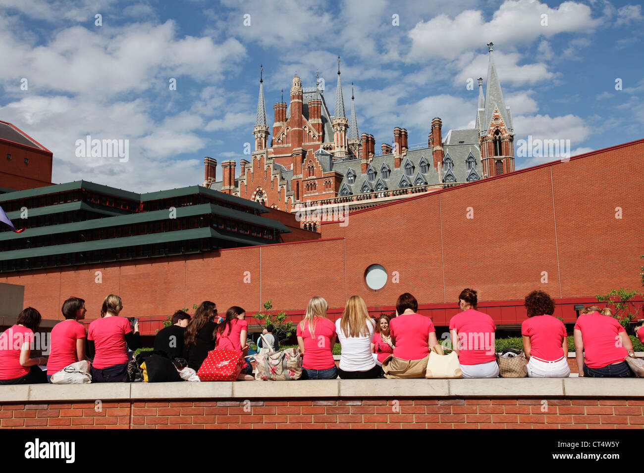 College group meet outside British Library with St. Pancras station in background. London 2012. UK - Stock Image