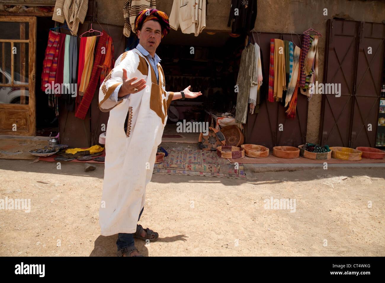 Local Berber Stallkeeper selling goods, Imlil, Morocco Africa - Stock Image