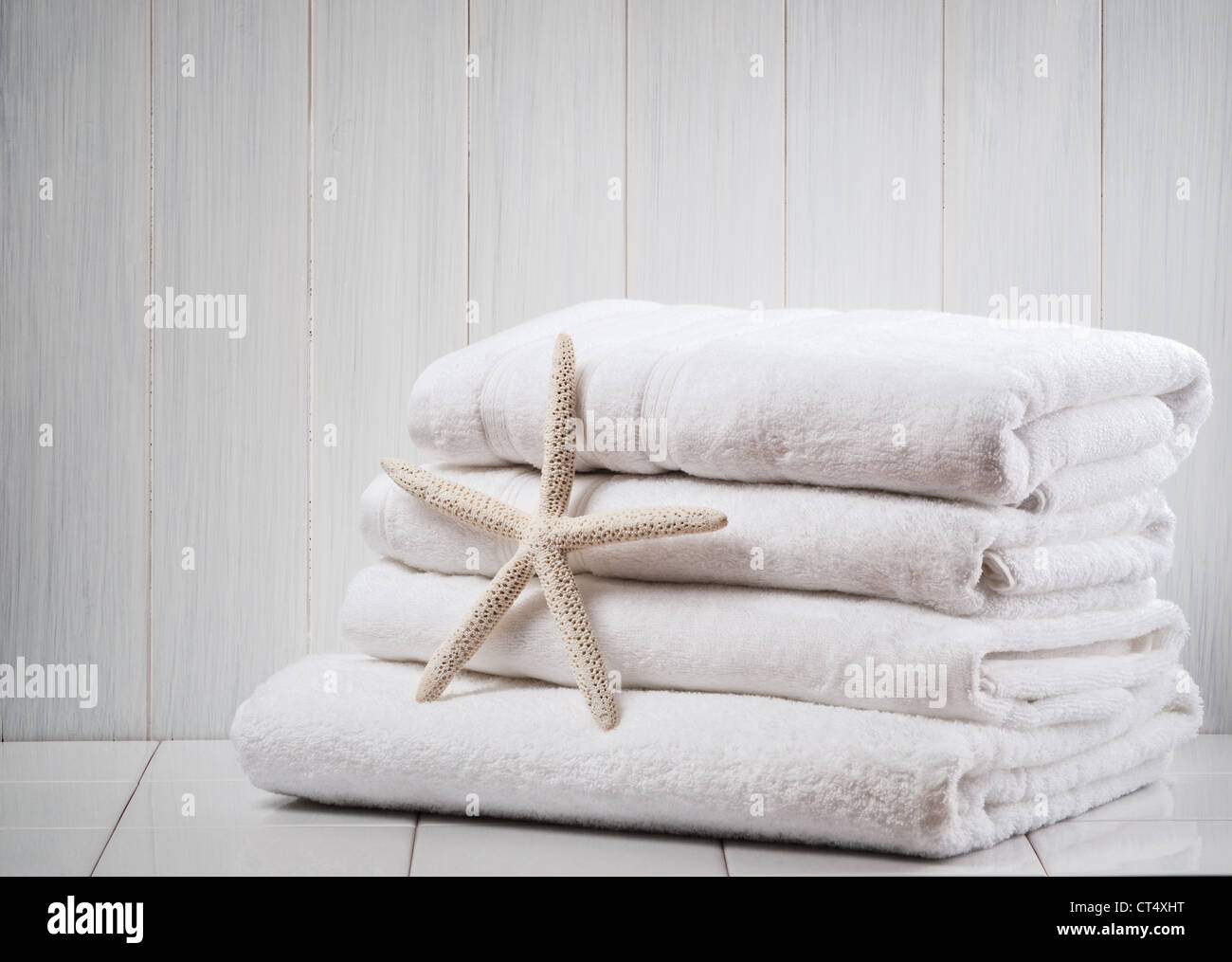 New white fluffy towels with starfish - Stock Image