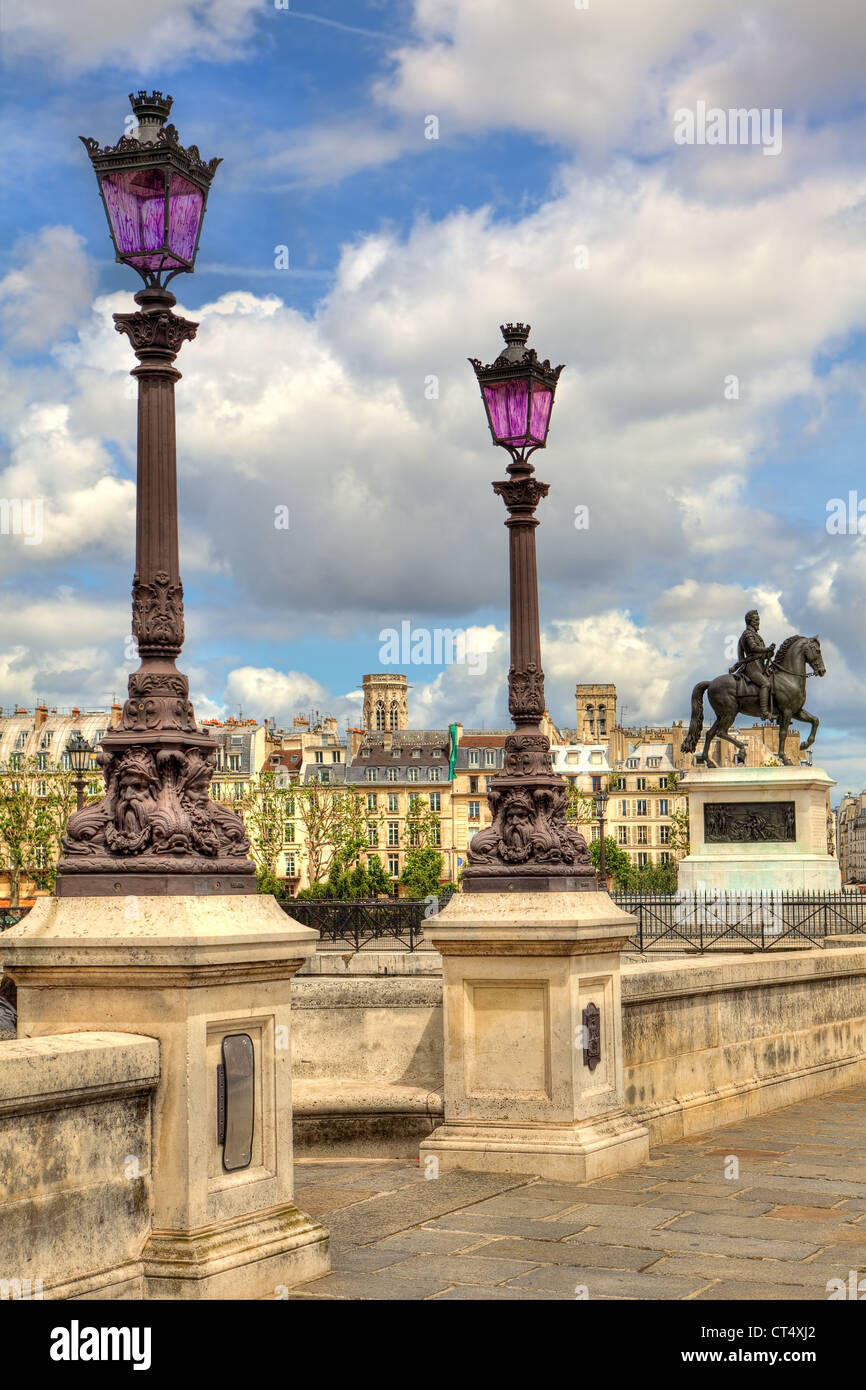 Vertical oriented image of traditional parisian lamppost on famous Pont Neuf bridge in Paris, France. - Stock Image