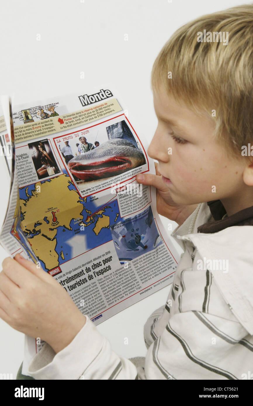 CHILD READING - Stock Image