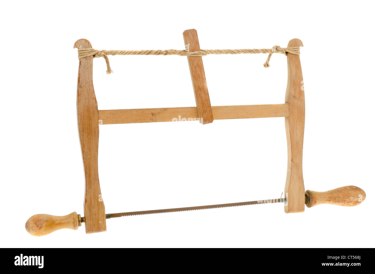 Antique carpenters bow saw - studio shot on a white background. - Stock Image