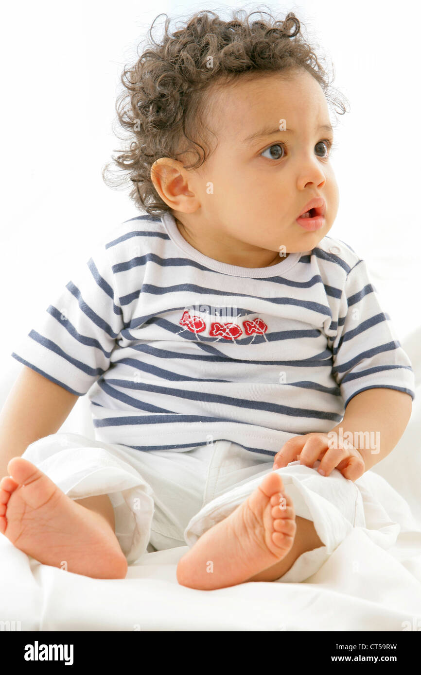 INFANT INDOORS - Stock Image