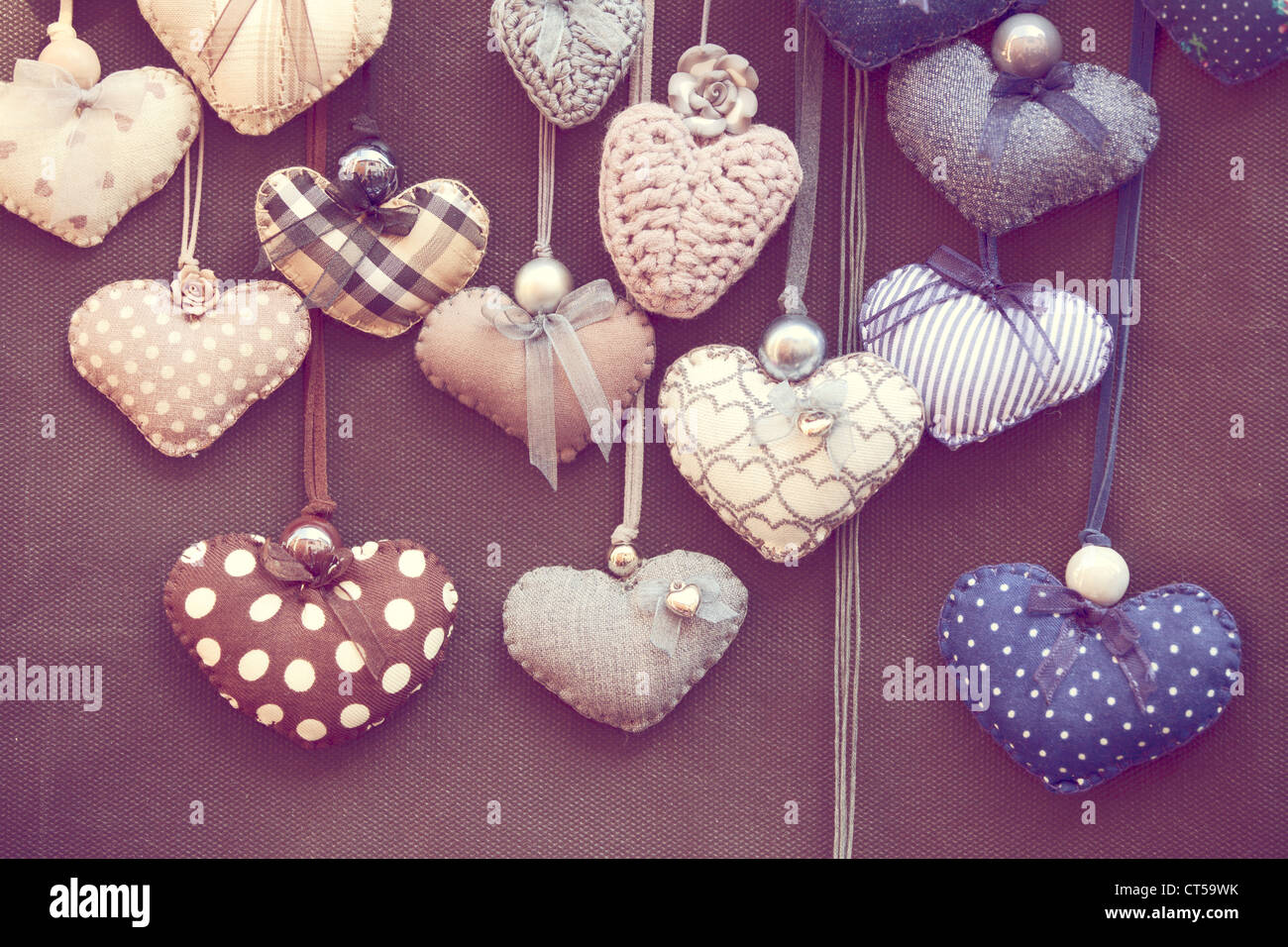 Toned photo of group of handmade hearts in romantic shabby chic style - Stock Image