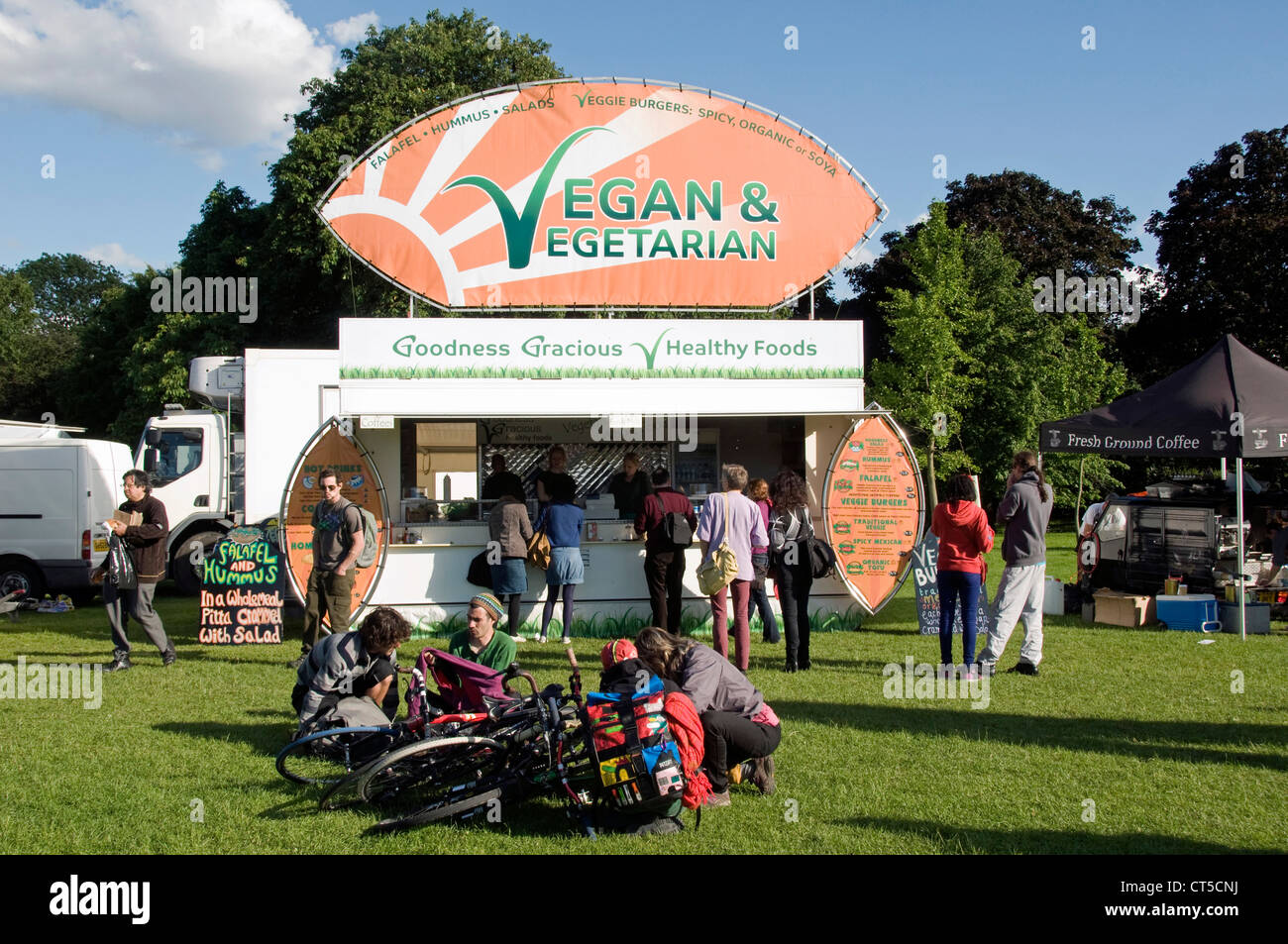 Vegan Vegetarian Food Stall With People And Bikes Around