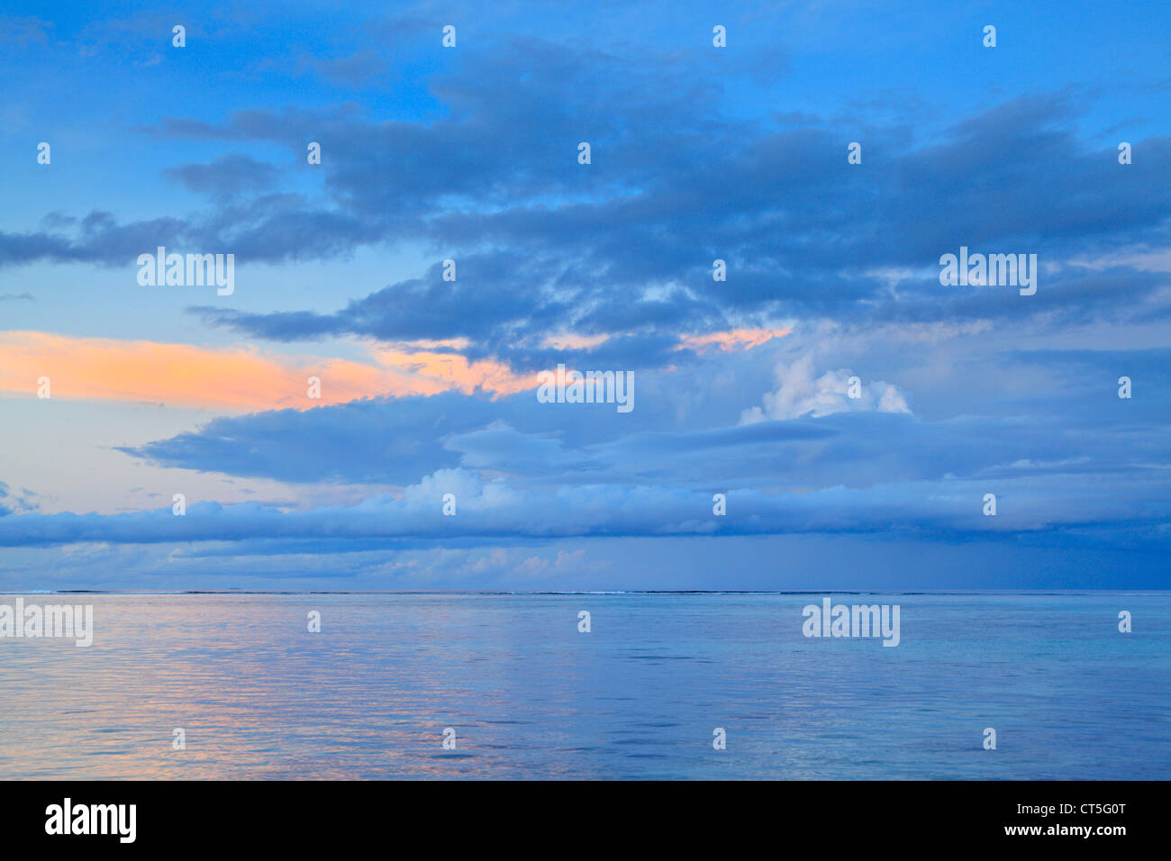 Morning twilight off the west coast of La Digue in the Seychelles Stock Photo