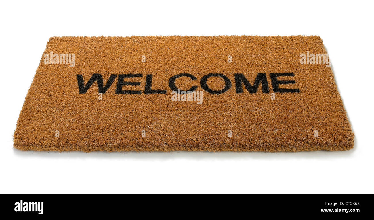 overhead view of a hessian straw hemp welcome mat isolated on white - Stock Image