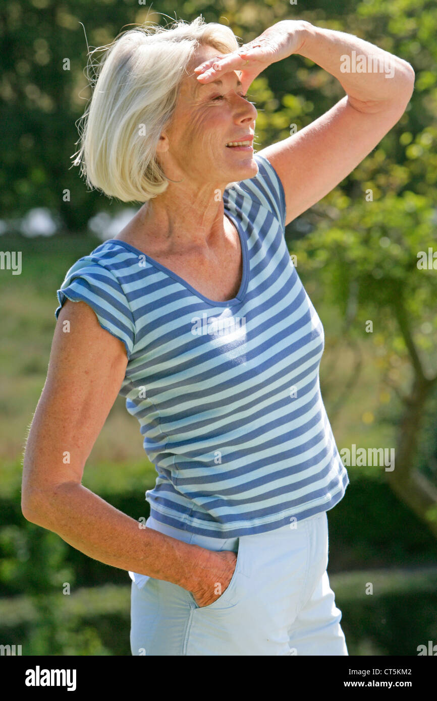 ELDERLY PERSON OUTDOORS - Stock Image