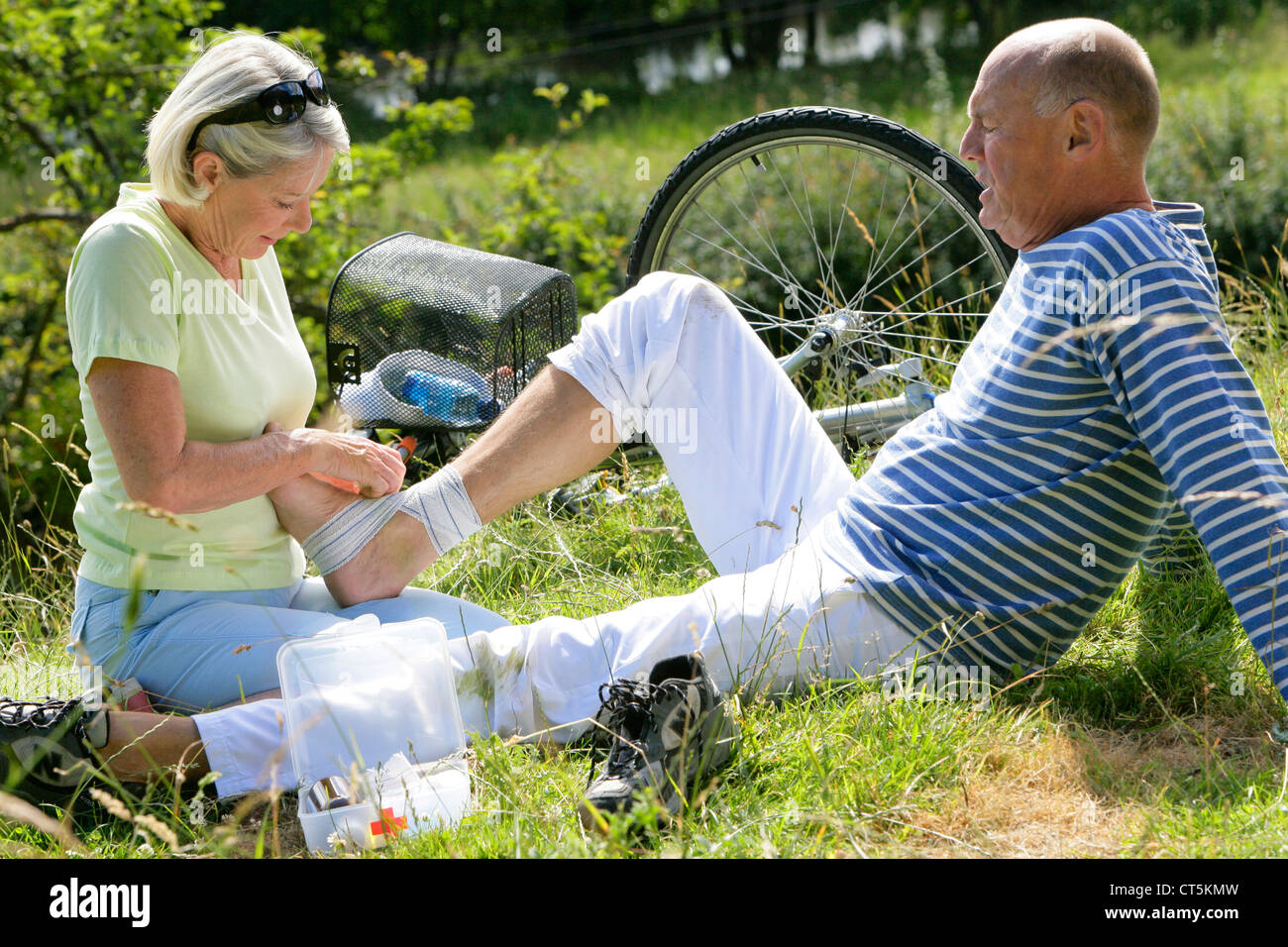 ELDERLY P. WITH SPRAINED ANKLE - Stock Image