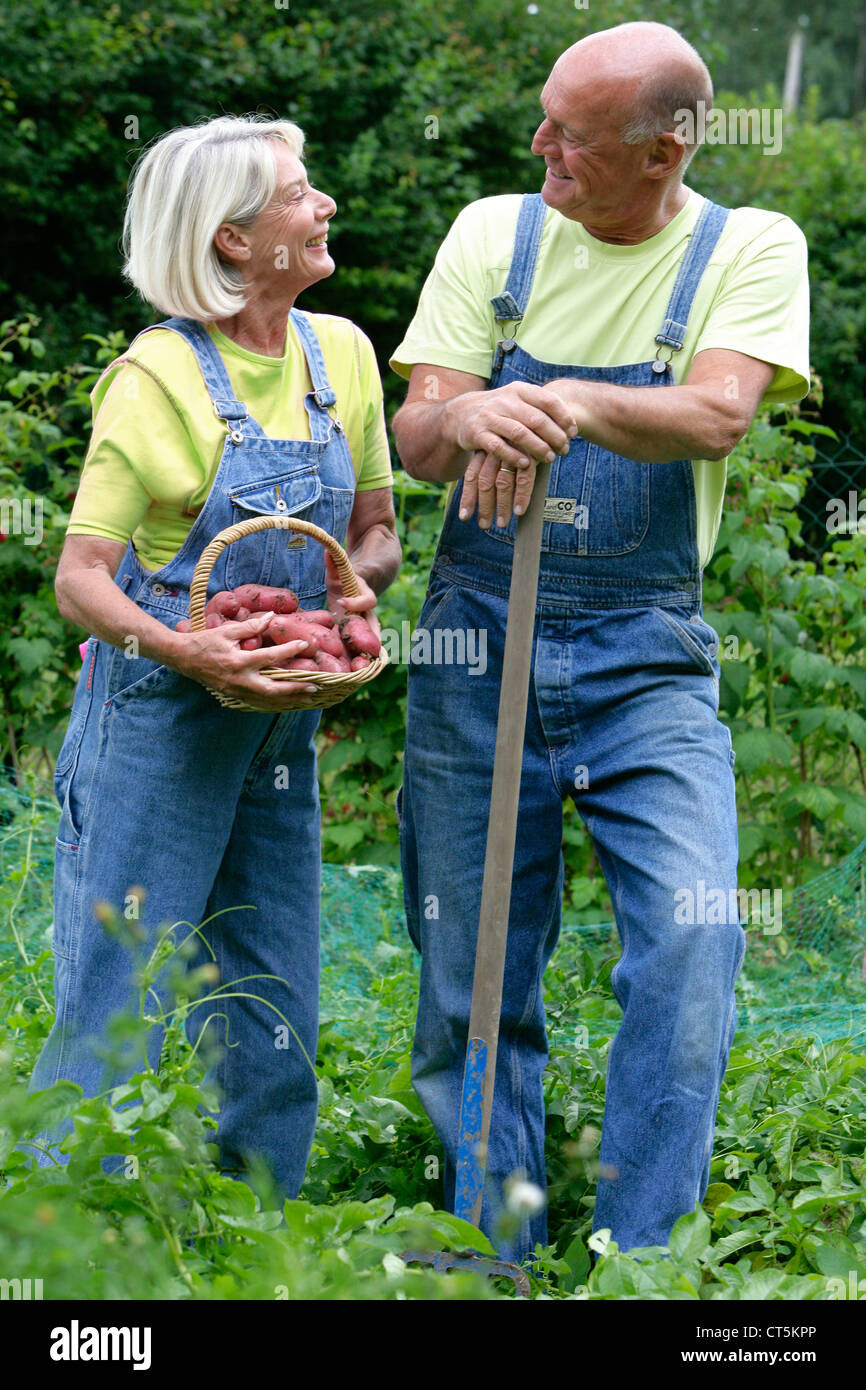 ELDERLY PERSON GARDENING - Stock Image