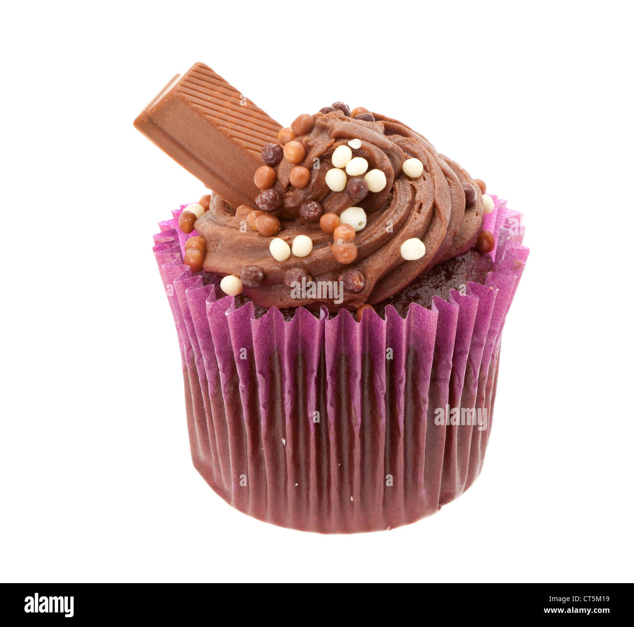 Chocolate cup cake with buttercream icing and a chocolate bar - studio shot with a white background - Stock Image