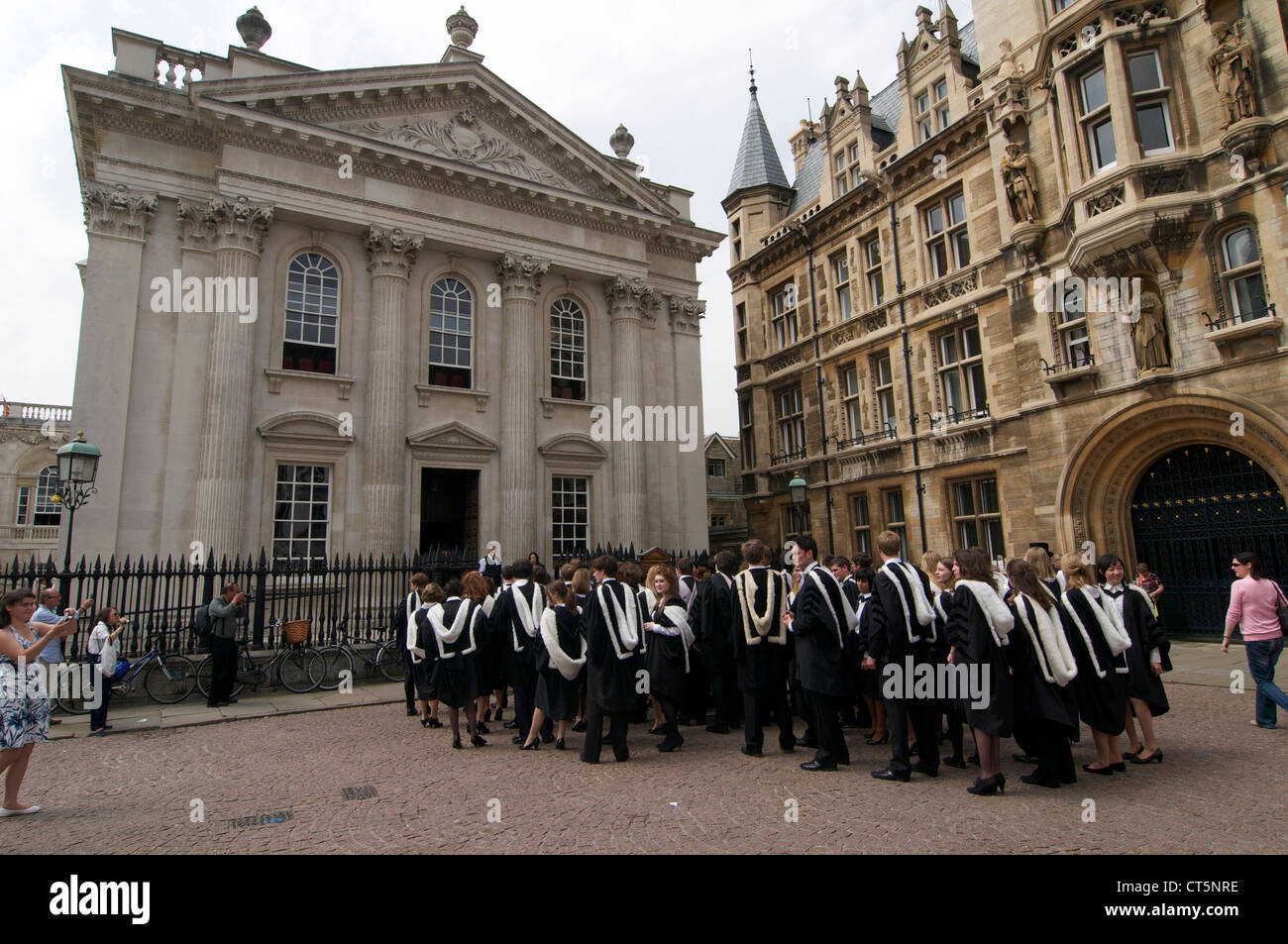 Cambridge University Students waiting on King's Parade outside Regent House for their graduation ceremony. - Stock Image