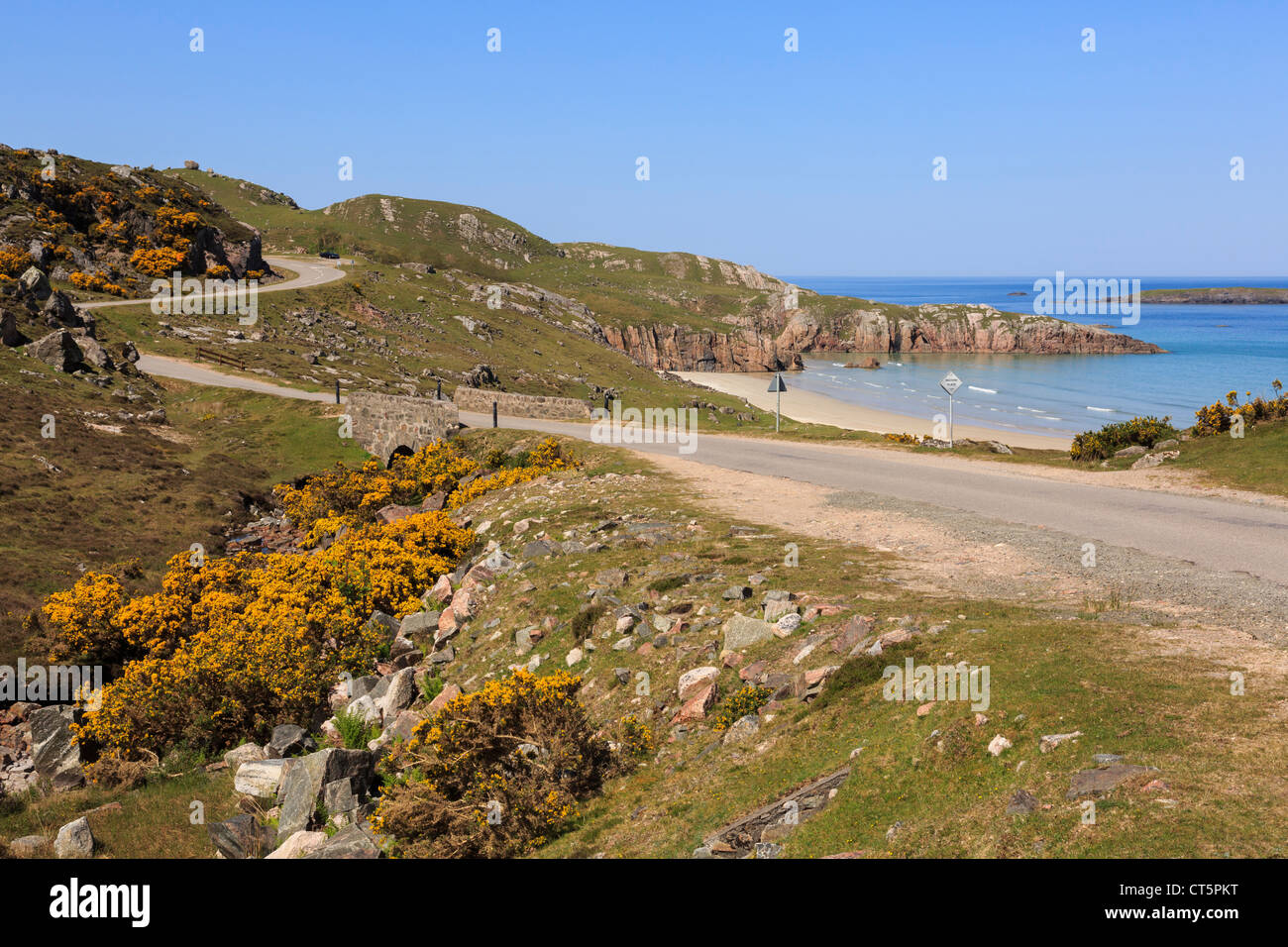 Single track road on North and West Highlands North Coast 500 Tourist Route along A838 by Ceannabeinne beach in - Stock Image