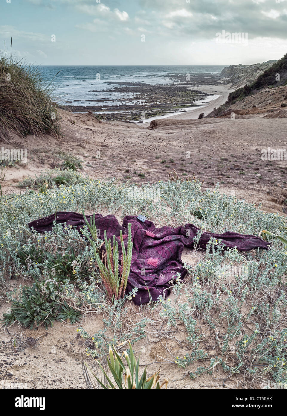 Wet clothes on the beach from a illegal immigrant in Tarifa, Cadiz, Andalusia, Spain. - Stock Image